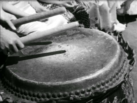 B/W 1930s close up hands beating drum / Chinatown, San Francisco / travelogue