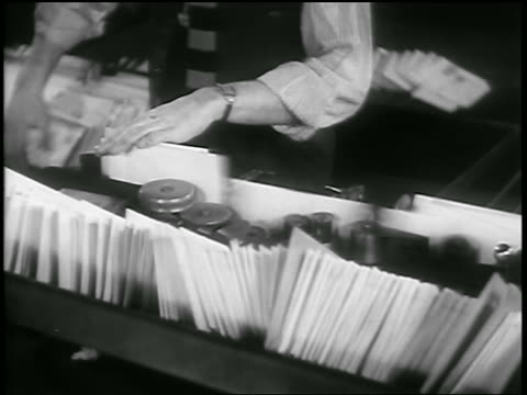 b/w 1930s close up man running letters thru machine / newsreel - post office stock videos & royalty-free footage