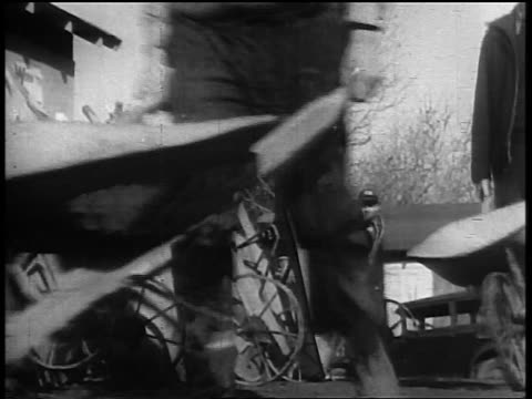 b/w 1930s close up men's torsos pushing wheelbarrows past camera during great depression / wpa - wheelbarrow stock videos and b-roll footage
