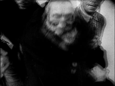 b/w 1930s close up senior jewish man being dragged by men / nazi takeover of germany - judaism stock-videos und b-roll-filmmaterial