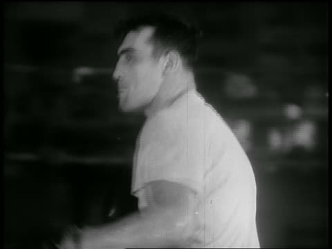 b/w 1930s close up side view boxer hitting punching bag in gym - one mid adult man only stock videos & royalty-free footage