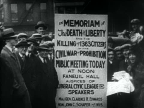 b/w 1930s crowd of people standing by sign for repeal of prohibition advocates meeting / boston - 禁酒法点の映像素材/bロール