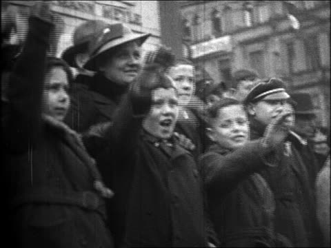 1930s crowd of women + children saluting at nazi parade in demilitarized rhineland - nazism stock videos & royalty-free footage