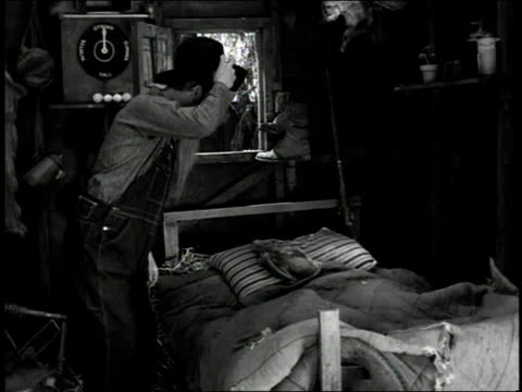 vidéos et rushes de 1930s ms farmer getting into bed with a goat and chickens / united states - captive animals