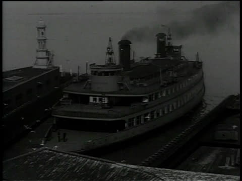 1930s ws ferry leaving the dock / san francisco, california, united states - san francisco california stock-videos und b-roll-filmmaterial