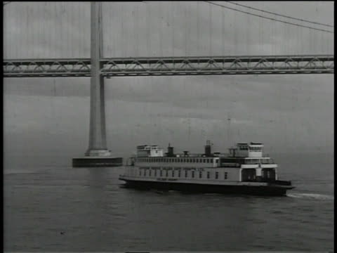 1930s WS ferry steaming past the Golden Gate Bridge / San Francisco, California, United States