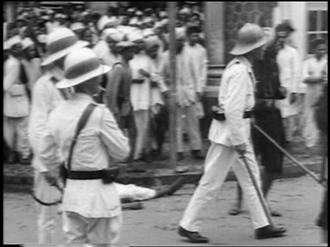 1930s from police to retreating crowd of anti-british protesters / new delhi, india - indian ethnicity stock videos & royalty-free footage