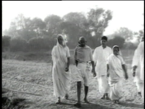 stockvideo's en b-roll-footage met 1930s gandhi walking with a group of people / india - mahatma gandhi