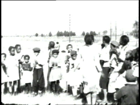 1930s ms girls dancing while other children clap hands / south carolina, united states - 分校点の映像素材/bロール
