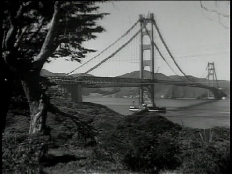 vídeos de stock, filmes e b-roll de 1930s ws golden gate bridge / california, united states - baía de são francisco