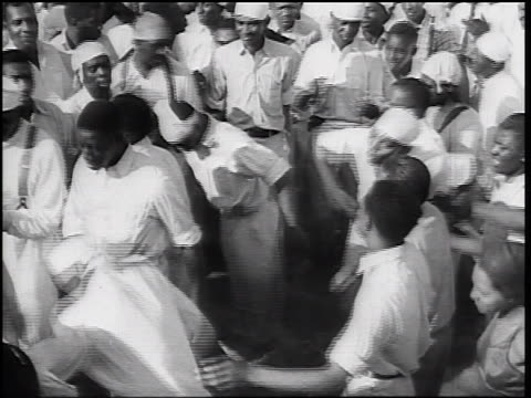 b/w 1930s group of black baptists with white garments dancing + singing - baptist stock videos & royalty-free footage