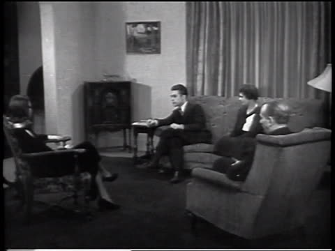 b/w 1930s group of people sitting in living room listening to radio / industrial - radio stock videos and b-roll footage