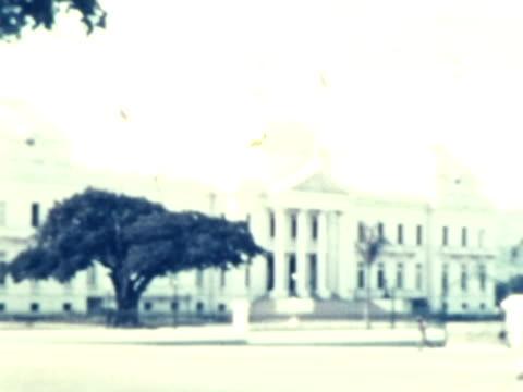 stockvideo's en b-roll-footage met 1930s ws pan haitian government building / haiti - haïti