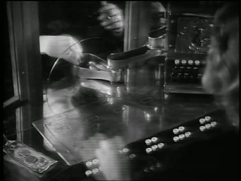 b/w 1930s hand of people buying tickets at theater box office - ticket stock videos & royalty-free footage