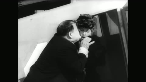 1930s hardy is threatened by a man (reginald gardiner) after kissing a woman (jean parker) - 1930 1939 stock videos & royalty-free footage