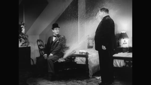 1930s hardy takes laurel's hyperbole literally leading to a declaration of suicide - 1930 1939点の映像素材/bロール