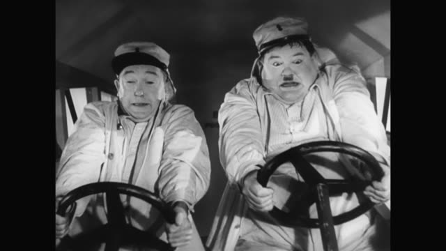 1930s hiding in an airplane complicates things for laurel and hardy - 1930 1939 stock-videos und b-roll-filmmaterial