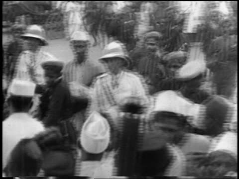 1930s high angle british + indian police wielding sticks during demonstration / new delhi, india - indian ethnicity stock videos & royalty-free footage
