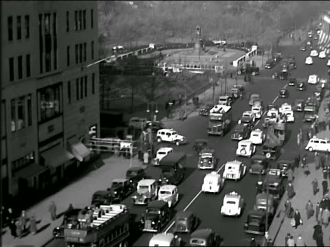 b/w 1930s high angle tilt down traffic on fifth avenue at 57th street in nyc - fifth avenue stock videos & royalty-free footage
