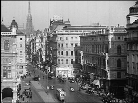 B/W 1930s high angle wide shot buildings + city street with traffic / Vienna, Austria
