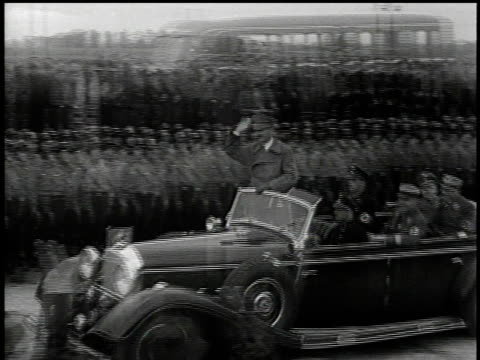 1930s hitler standing in a car as it breaks the ceremonial tape signifying the opening of the autobahn / germany - nazism stock videos & royalty-free footage