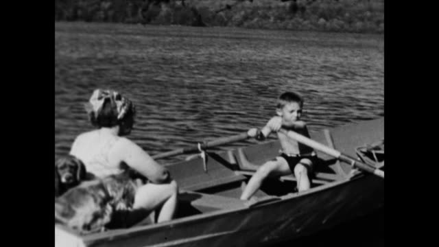 1930s Home Movie - Boy, Mother and dog in small boat