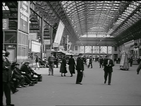 b/w 1930s interior of train station with people walking + sitting / paris, france - 1930 stock videos and b-roll footage