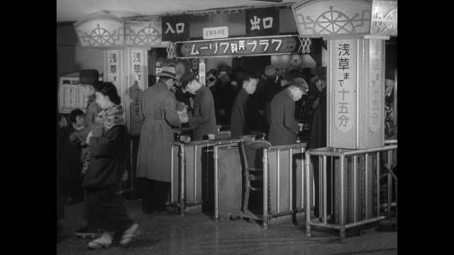 japan modernization vs japanese people in varied clothing traditional nontraditional walking down into/out of subway metro area ws people passing... - 1930 stock-videos und b-roll-filmmaterial