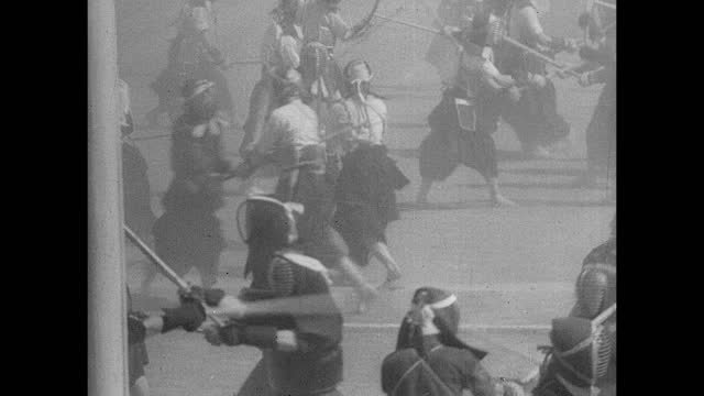 japan rise of militarism td ws many japanese soldiers practicing kendo on each other kicking up lots of dust japanese emperor hirohito w/ binoculars... - 1930 stock-videos und b-roll-filmmaterial
