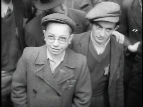 1930s pan jewish teenagers with stars of david on shirts looking at the camera and smiling / dombrova poland - poland stock videos & royalty-free footage