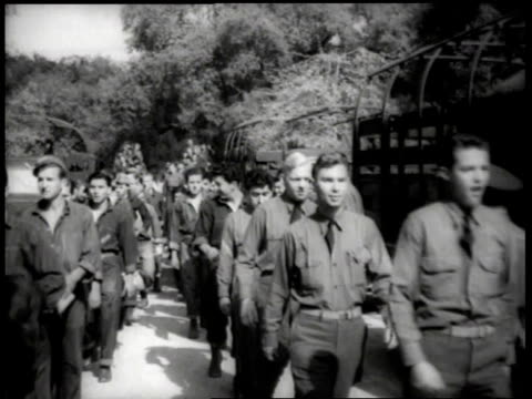 1930s large group of farm workers walking in line and getting into trucks / united states - lavoratore emigrante video stock e b–roll