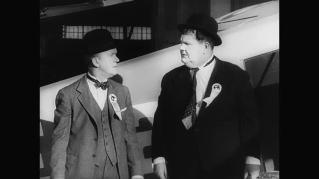 1930s laurel and hardy are arrested for desertion - 1930 1939 stock-videos und b-roll-filmmaterial