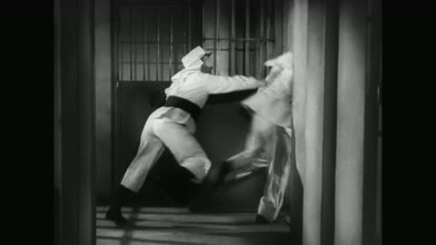 1930s laurel and hardy are placed in a jail cell by an incompetent worker - 1930 1939 stock videos & royalty-free footage