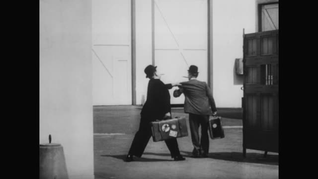 1930s laurel and hardy make a narrow escape - 1930 1939 stock videos & royalty-free footage
