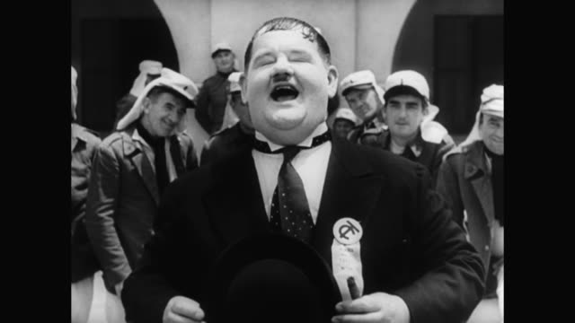 1930s laurel and hardy perform a musical number with the moroccan military band - 1930 1939 stock-videos und b-roll-filmmaterial
