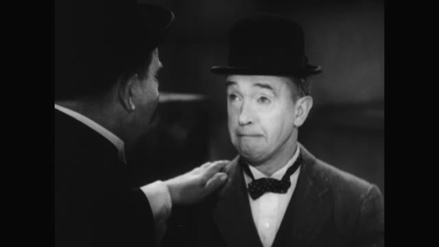 1930s laurel falls for hardy's manipulation - distraught stock videos & royalty-free footage