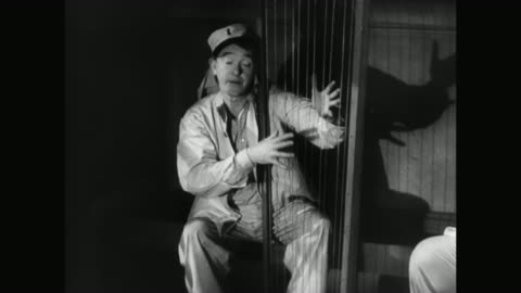 1930s laurel plays a makeshift harp in a jail cell - 1930 1939 stock videos & royalty-free footage