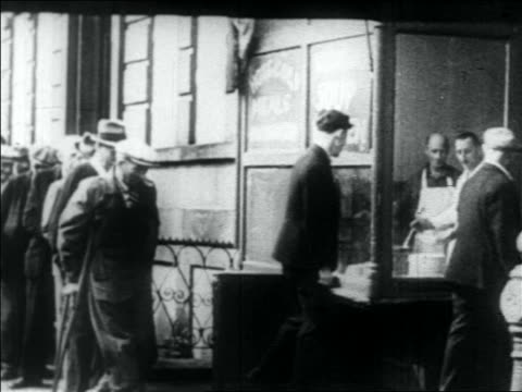 b/w 1930s line of men entering soup kitchen / great depression - soup kitchen stock videos & royalty-free footage