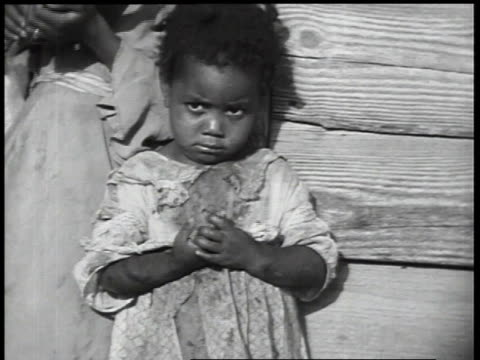 1930s cu little girl standing against wall / united states - girls stock videos & royalty-free footage