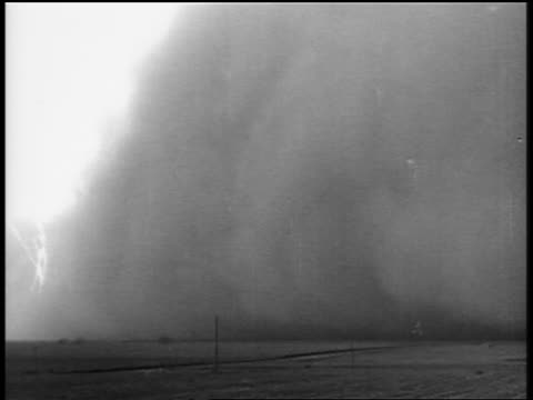 b/w 1930s long shot huge cloud of dust on plain during dust storm / dust bowl - great depression stock videos & royalty-free footage