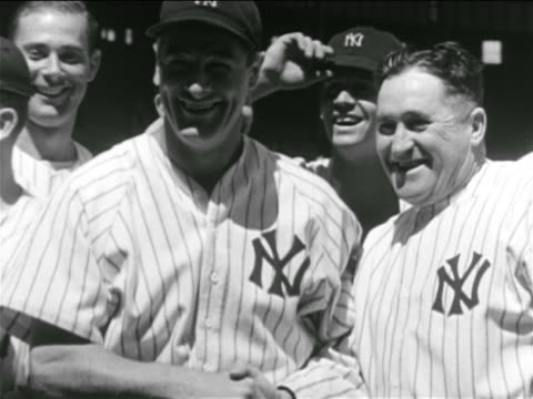b/w 1930s lou gehrig yankees manager joe mccarthy smiling outdoors / other players in background - lou gehrig stock videos & royalty-free footage