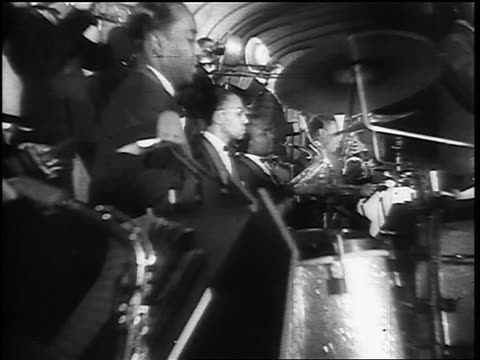 B/W 1930s low angle PROFILE Black male jazz musicians in swing orchestra
