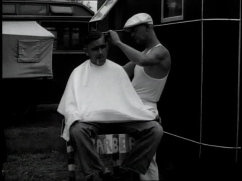 1930s ms man getting a haircut next to a trailer / miami, florida, united states - 1930 stock videos and b-roll footage