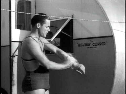 1930s ms man in a bathing suit washing himself outside a trailer / miami, florida, united states - miami stock videos & royalty-free footage