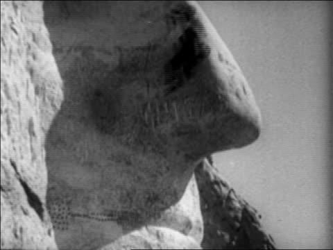 1930s man rappelling down nose of george washington on mt. rushmore / south dakota / newsreel - human nose stock videos & royalty-free footage