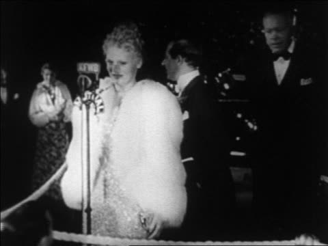 1930s marie wilson at microphone at hollywood premiere at grauman's chinese theater / newsreel - film premiere stock videos & royalty-free footage