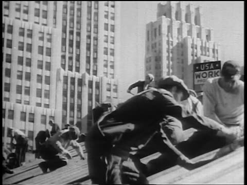 b/w 1930s men working on roof of building in city during great depression / wpa - new deal video stock e b–roll