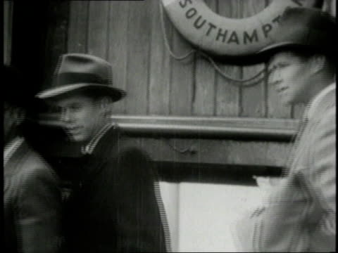 1930s montage ambassador joseph kennedy arriving in united kingdom with his sons joseph kennedy jr and john f kennedy / great britain - botschafter stock-videos und b-roll-filmmaterial