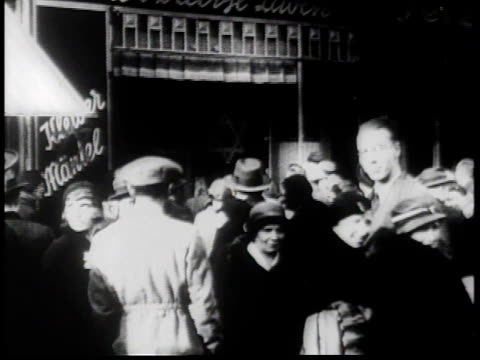 1930s montage antisemitic signs in berlin with brown shirts on street corners / germany - judaism stock videos & royalty-free footage