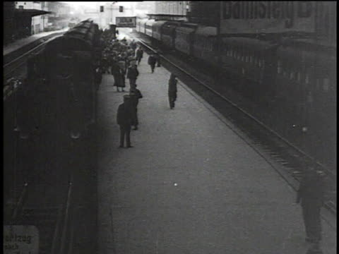 1930s MONTAGE Busy railroad station / Berlin, Germany